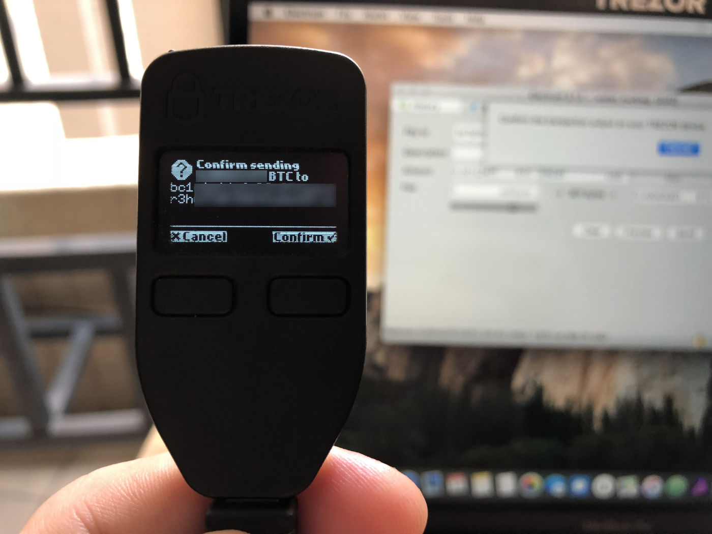 Confirming the transaction address on Trezor.